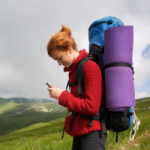 Woman using her phone while hiking